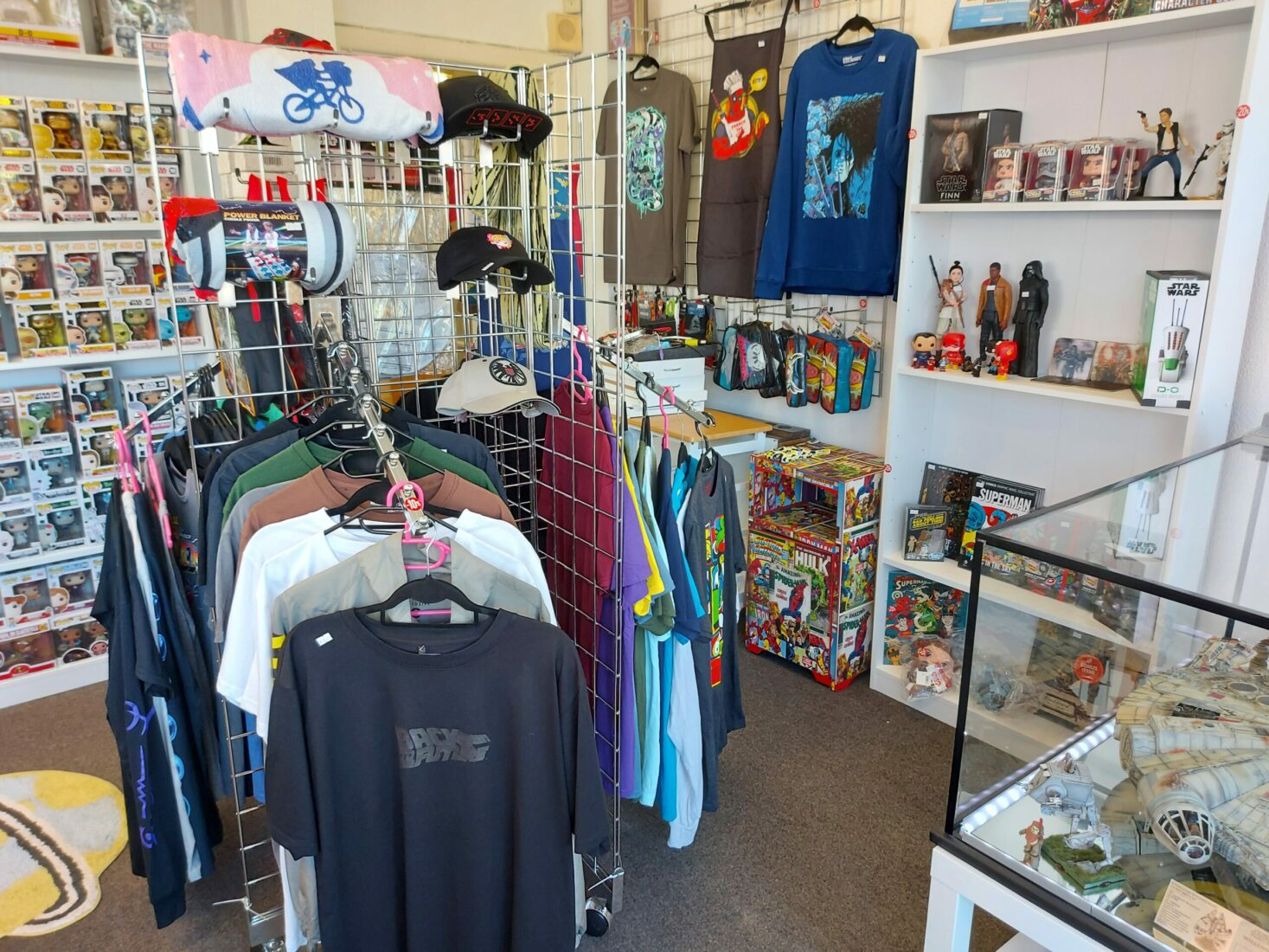 Inside photo of Dorset Tech shop of t-shirt rail and merch